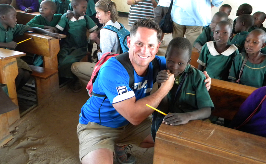 Aquavolve's VP of International Relations, Chris Mancini, working with school children in Tanzania, 2012