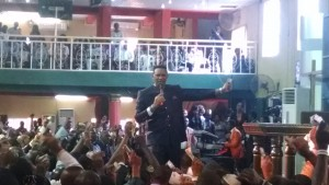 Dr. Chris Okafor preaches to his congregation on December 7, 2014